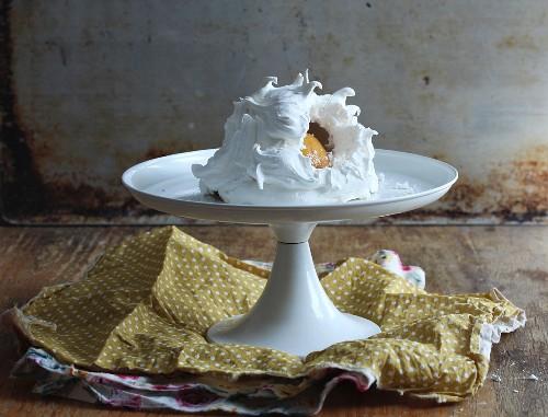 Pavlova with fruit on a cake stand