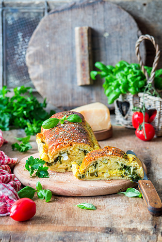 Bread filled with cheese and green herbs