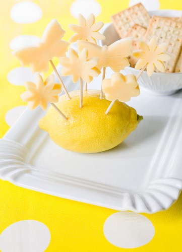 Flower and butterfly shaped cheese skewers served with crackers