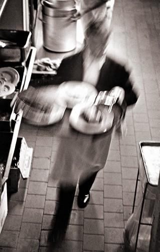 A waiter at work (motion blur)