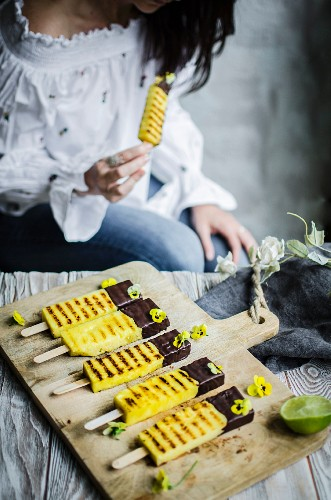Charred pineaplle sticks sipped in dark chocolate