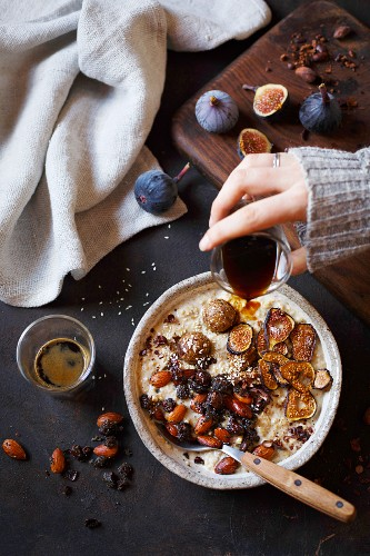 A date smoothie bowl with oatmeal and cocoa nibs