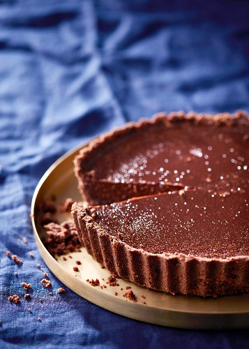 Dark chocolate tart, with a small slice removed
