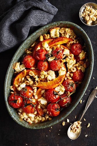 Roasted pumpkin with cherry tomatoes, sheep's cheese, and hazelnuts