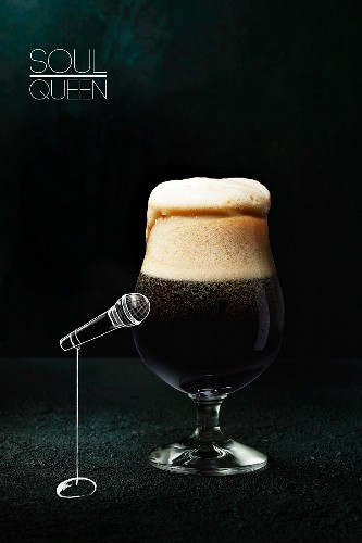 Dark beer in a glass with an illustration