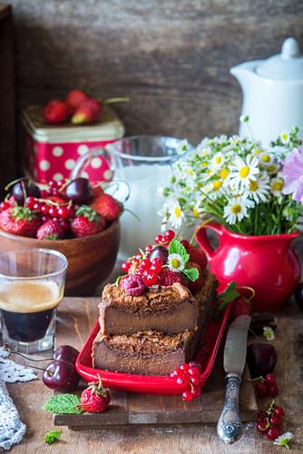 Chocolate magic cake with fresh berries