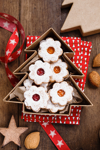 Christmas biscuits with red and yellow jam in a tree shaped box