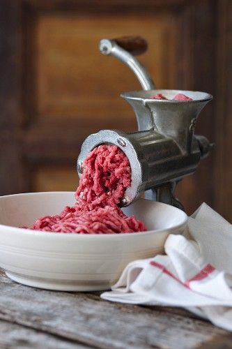 A meat grinder with freshly ground minced meat