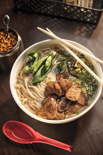 Beef Noodle Soup garnished with cilantro and scallions