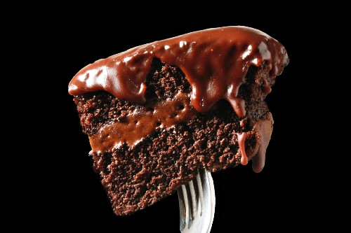A piece of chocolate cake on a fork