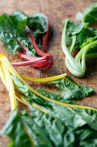 Three different kinds of chard on a wooden board