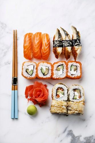 Sushi Set nigiri and sushi rolls on white marble background