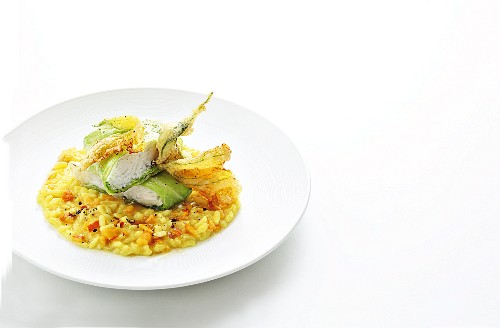Cod wrapped in pointed cabbage with pumpkin risotto and baked pumpkin blossoms