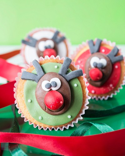 Christmas cupcakes with fondant icing and reindeer faces