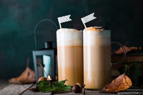 Caffe lattes with pumpkin puree, caramel and cream