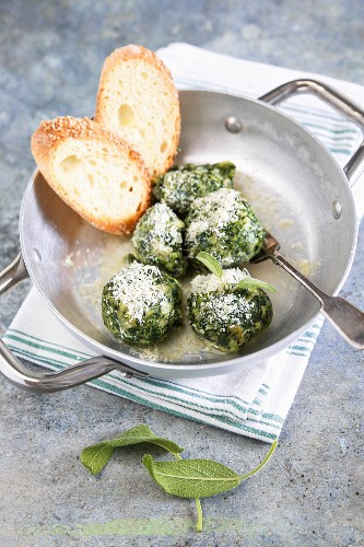 Homemade Canederli with spinach served with butter sage and parmesan cheese