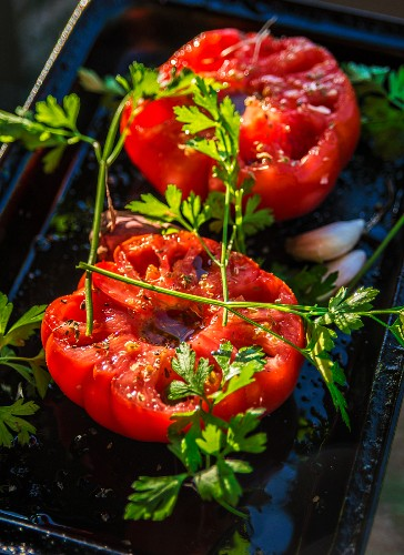 Roasted tomato halves with garlic and herbs, fresh from the oven