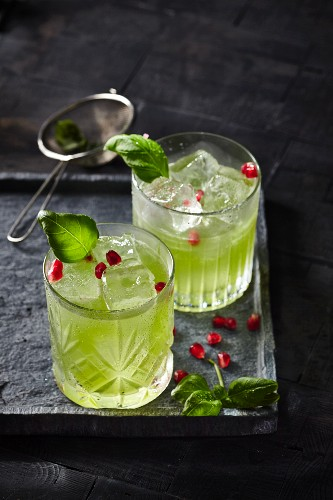 Gin Basil Smash cocktails with pomegranate seeds
