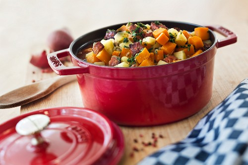 Carrot and potato stew with sausage