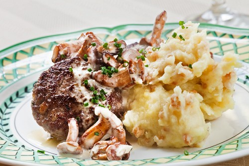 A veal meatball with chanterelle mushrooms and mashed potato