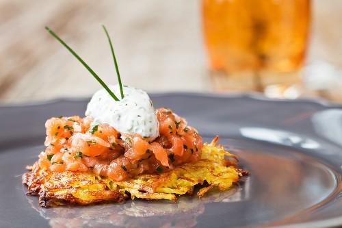 Salmon tartare on a potato fritter with herb quark