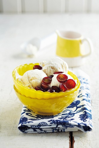 Vanilla ice cream with red grapes in brandy