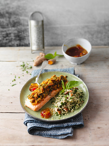 Salmon with a turmeric and herb crust served with almond bulgur