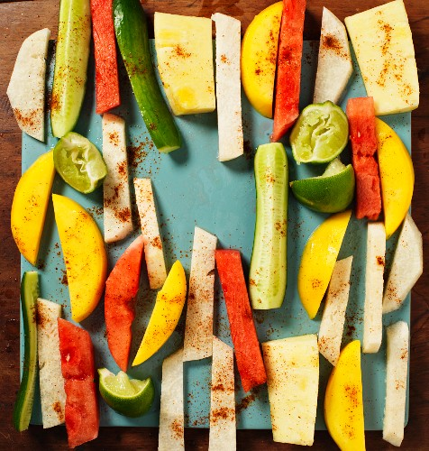 Jicama, vegetables and fruit cut into strips with lines and spices
