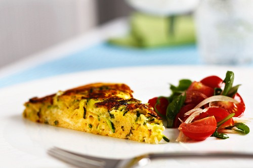 Courgette omelette with tomato salad