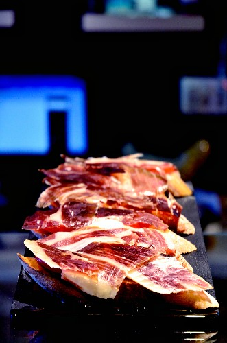 Crostini with Iberian ham on a bar