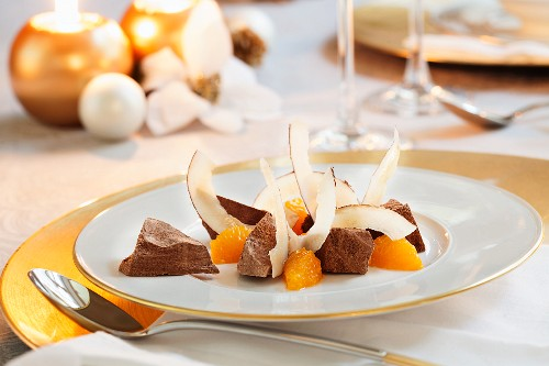 Iced chocolate cinnamon stars with oranges and coconut for Christmas