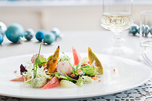 Lobster with grapefruit, avocado and a salad garnish for Christmas