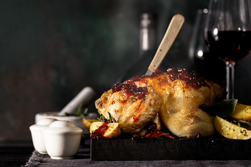 Roast chicken with potatoes and cranberry sauce
