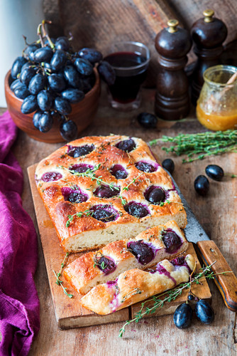 Focaccia with grapes and thyme, sliced