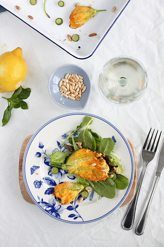 Stuff courgette flowers with ricotta, pine nuts, lemon and basil served with white wine