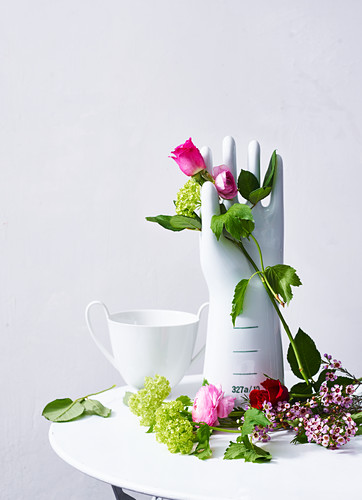 A porcelain hand decorated with flowers for Mother's Day