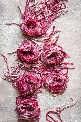 Uncooked homemade beetroot pasta view from above