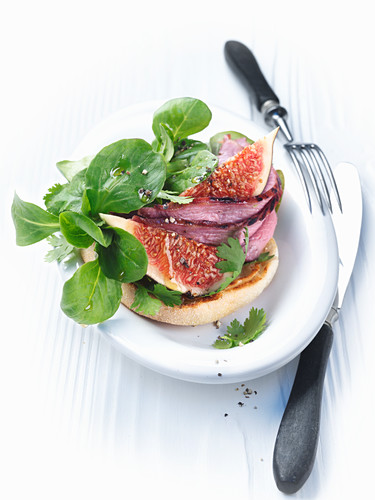 Marinated duck breast with a fig and coriander salad