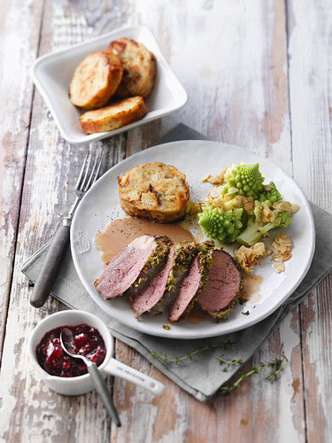 Saddle of venison in a herb crust with Romanesco broccoli and bread dumplings