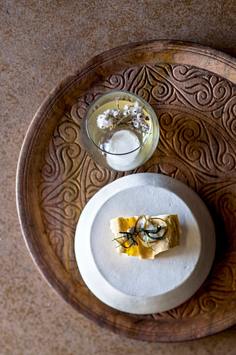 An amuse-bouche is served with a housemade vermouth