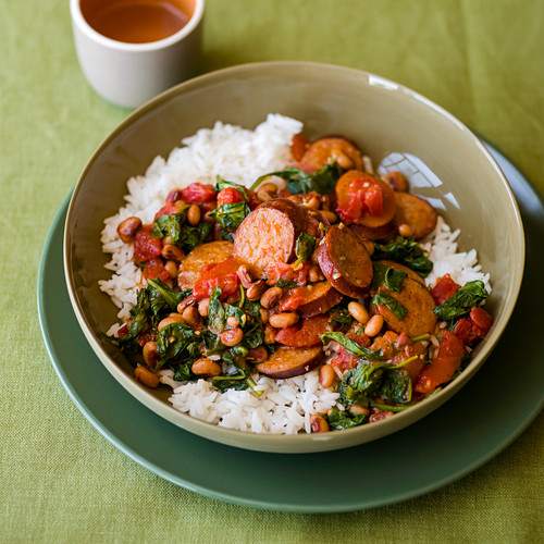Spiced Turkey Sausage with Black-Eyed Peas and Spinach over rice