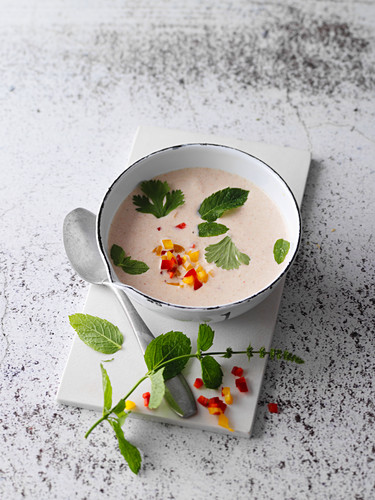 Cold yoghurt and pepper soup with feta cheese and moringa