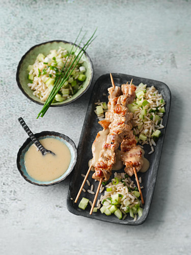 Satay skewers with a peanut sauce and cucumber rice