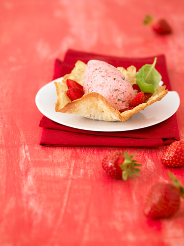 Strawberry and basil mousse with an almond wafer