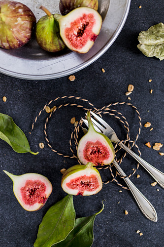 An arrangement of figs including halved figs
