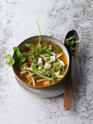 Vegan miso soup with tofu and herbs