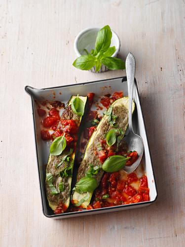 Oven-baked courgette filled with basil and silken tofu