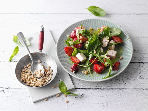 Rocket and strawberry salad with sheep's cheese and pine nuts