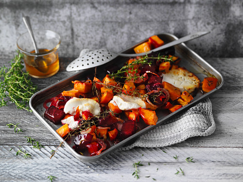 Oven-baked root vegetables with goat's cheese