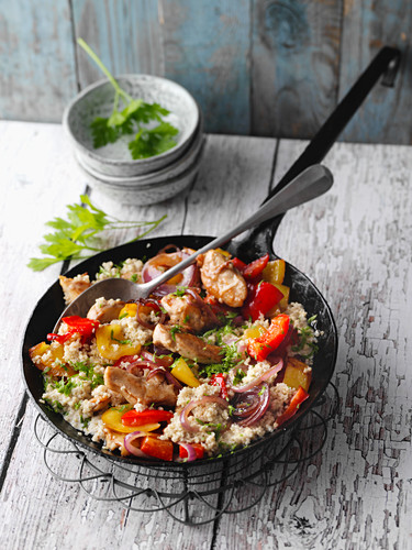 Fried quinoa and peppers with chicken breast